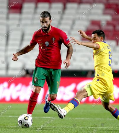 Sergio Oliveira of Portugal (L) vies with Aaron Sanchez of Andorra during a friendly football match at the Luz stadium in Lisbon, Portugal, on Nov. 11, 2020.