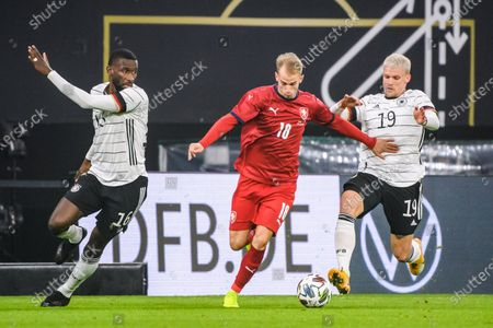 Philipp Max (R) and Antonio Ruediger (L) of Germany vie with Vaclav Cerny of the Czech Republic during a friendly football match in Leipzig, Germany, Nov. 11, 2020.