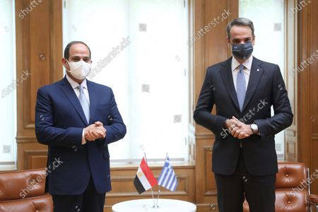 "Greek Prime Minister Kyriakos Mitsotakis (R) and the visiting Egyptian President Abdel Fattah al-Sisi are seen at the Prime Minister's Office in Athens, Greece, Nov. 11, 2020. TO GO WITH: ""Egypt's president in Greece to discuss bilateral cooperation, regional issues"""