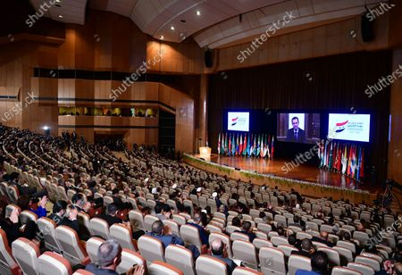 A screen shows Syrian President Bashar al-Assad giving a speech at the International Refugees Conference held in Damascus, Syria, Nov. 11, 2020. Around 27 countries and 12 organizations took part in the two-day conference aimed at highlighting the Syrian government's efforts to facilitate the return of Syrian refugees back to Syria.    Several foreign ambassadors in Syria attended the conference, which is co-organized by Russia.