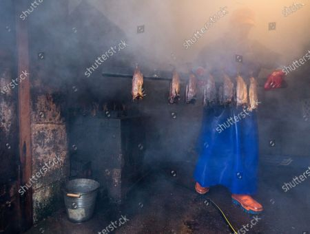 A proprietor of Arbroath Fisheries Ltd. Campbell Scott, removes a new batch of smokies at his smokery in Arbroath, Scotland, Britain, 11 November 2020. A Smokie is a hot smoked haddock cooked in a barrel over an open flame. The company use Scottish haddock sourced from the cold waters of the North Sea and still produce it using traditional methods. Having attained PGI Status in 2004 Arbroath Smokies can only be produced within a five mile radius of the town center and enjoy the same status as Parma Ham and Champagne. The methods are strictly monitored to ensure customers are receiving the genuine article.
