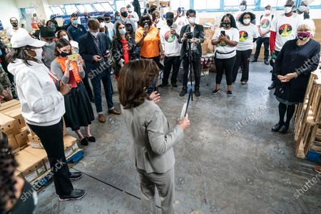 Volunteers and staff listen as Lieutenant Governor Kathy Hochul speaks at deliver fresh local food to veterans during HelloFresh Veterans Day Packing Event in Brooklyn. The Governor's Office bought excessive produce from New York State farmers and donated it for distribution among needy people.
