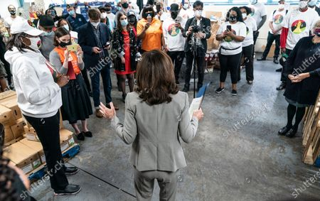 Stock Picture of Volunteers and staff listen as Lieutenant Governor Kathy Hochul speaks at deliver fresh local food to veterans during HelloFresh Veterans Day Packing Event in Brooklyn. The Governor's Office bought excessive produce from New York State farmers and donated it for distribution among needy people.