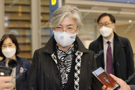 Foreign Minister Kang Kyung-wha answers a reporter's question after arriving at Incheon International Airport in Incheon, west of Seoul, South Korea, 12 November 2020,  following her four-day visit to the United States.