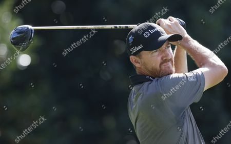 Stock Picture of Jimmy Walker of the US hits his tee shot on the fifteenth hole during the first round of the 2020 Masters Tournament at the Augusta National Golf Club in Augusta, Georgia, USA, 12 November 2020. After being delayed seven months by the coronavirus pandemic, the 2020 Masters Tournament is being held without patrons 12 November through 15 November.