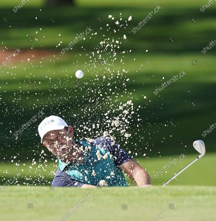 Stock Photo of Charl Schwartzel of South Africa hits out of a bunker on the second hole during the first round of the 2020 Masters Tournament at the Augusta National Golf Club in Augusta, Georgia, USA, 12 November 2020. After being delayed seven months by the coronavirus pandemic, the 2020 Masters Tournament is being held without patrons 12 November through 15 November.
