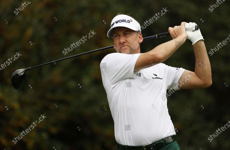 Stock Picture of Ian Poulter of England hits his tee shot on the fifteenth hole during the first round of the 2020 Masters Tournament at the Augusta National Golf Club in Augusta, Georgia, USA, 12 November 2020. After being delayed seven months by the coronavirus pandemic, the 2020 Masters Tournament is being held without patrons 12 November through 15 November.