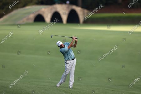 Stock Photo of Fred Couples of the US hits from the fairway with the Hogan Bridge behind him on the thirteenth hole during the first round of the 2020 Masters Tournament at the Augusta National Golf Club in Augusta, Georgia, USA, 12 November 2020. After being delayed seven months by the coronavirus pandemic, the 2020 Masters Tournament is being held without patrons 12 November through 15 November.