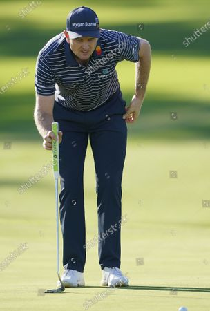 Justin Rose of England lines up his putt on the second hole during the first round of the 2020 Masters Tournament at the Augusta National Golf Club in Augusta, Georgia, USA, 12 November 2020. After being delayed seven months by the coronavirus pandemic, the 2020 Masters Tournament is being held without patrons 12 November through 15 November.
