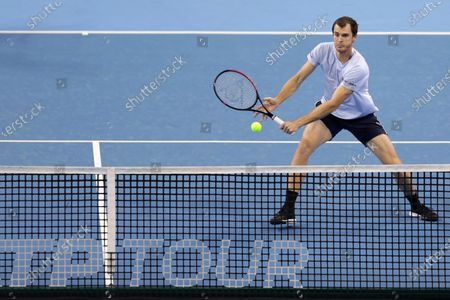 Stock Photo of Great Britain's Jamie Murray in action during their semi-final doubles match during the Sofia Open ATP 250 tennis tournament.