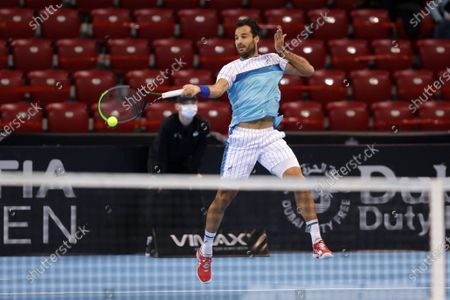 Italy's Salvatore Caruso in action during his quarter-final match against France's Richard Gasquet during the Sofia Open ATP 250 tennis tournament.