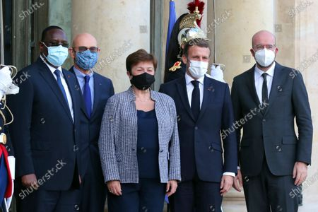 From left, Senegal's President Macky Sall, head of the Peace Forum, Pascal Lamy, International Monetary Fund Managing Director Kristalina Georgieva, France's President Emmanuel Macron and President of the European Council Charles Michel, pose for a photo prior to a meeting, at the Elysee Palace, in Paris, Thursday, Nov.12, 2020