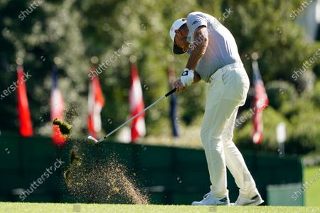 Lee Westwood, of England, hits on the first fairway during the first round of the Masters golf tournament, in Augusta, Ga