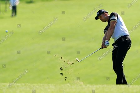 Henrik Stenson, of Sweden, hits on the first fairway during the first round of the Masters golf tournament, in Augusta, Ga