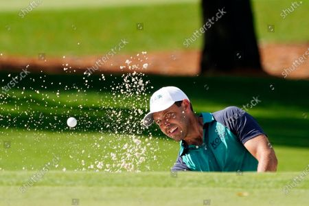 Charl Schwartzel, of South Africa, hits out of a bunker on the second hole during the first round of the Masters golf tournament, in Augusta, Ga
