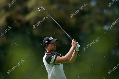 Henrik Stenson, of Sweden, watches his tee shot on the sixth hole during the first round of the Masters golf tournament, in Augusta, Ga