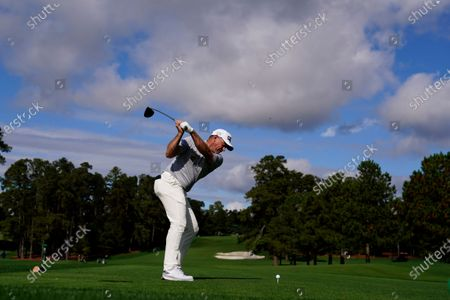 Lee Westwood, of England, tees off on the eighth hole during the first round of the Masters golf tournament, in Augusta, Ga
