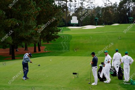 Sandy Lyle, of Scotland, tees off on the third hole during the first round of the Masters golf tournament, in Augusta, Ga
