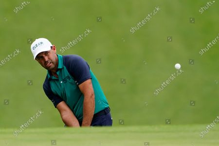 Charl Schwartzel, of South Africa, chips to the seventh green during the first round of the Masters golf tournament, in Augusta, Ga