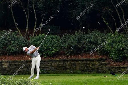 Lee Westwood, of England, tees off on the 13th hole during the first round of the Masters golf tournament, in Augusta, Ga