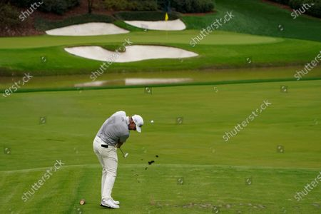 Lee Westwood, of England, tees off on the 12th hole during the first round of the Masters golf tournament, in Augusta, Ga