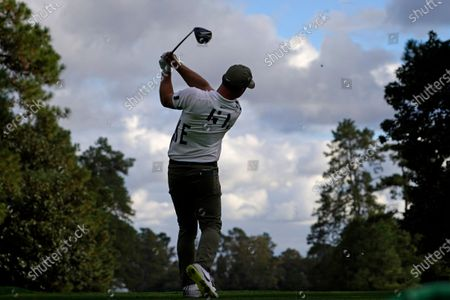 Paul Casey, of England, tees off on the ninth hole during the first round of the Masters golf tournament, in Augusta, Ga