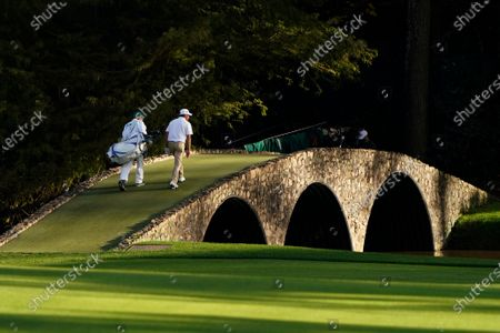 Jose Maria Olazabal, of Spain, walks over the bridge on the 13th green during the first round of the Masters golf tournament, in Augusta, Ga