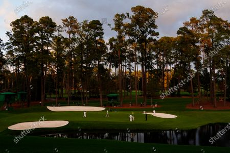 James Sugrue, of Ireland, Jose Maria Olazabal, of Spain, and Andrew Putnam play on the 16th green during the first round of the Masters golf tournament, in Augusta, Ga