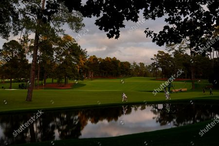 Jose Maria Olazabal, of Spain, and James Sugrue, of Ireland, walk to the 16th green during the first round of the Masters golf tournament, in Augusta, Ga