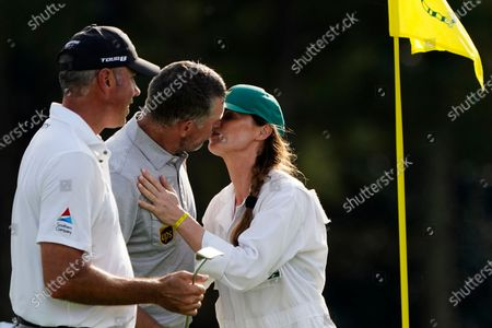 Stock Image of Lee Westwood, of England, kisses his caddie Helen Storey following his first round of the Masters golf tournament, in Augusta, Ga