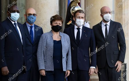 (L-R) Senegalese President Macky Sall, Pascal Lamy, head of the Peace Forum, International Monetary Fund Managing (IMF) Director Kristalina Georgieva, French President Emmanual Macron and European Council President Charles Michel  pose as they arrive for the opening of the Peace Forum summit, at the Elysee Palace in Paris, France, 12 November 2020.