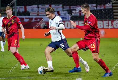 Jack Grealish of England between Kevin De Bruyne of Belgium and Thomas Meunier of Belgium