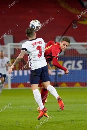 Thorgan Hazard of Belgium and Kieran Trippier of England challenge for a high ball