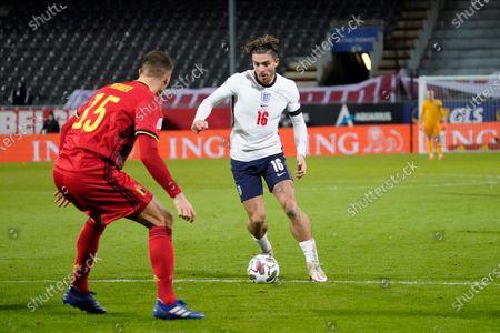 Jack Grealish of England takes on Thomas Meunier of Belgium