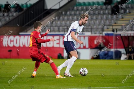 Harry Kane of England takes on Thorgan Hazard of Belgium