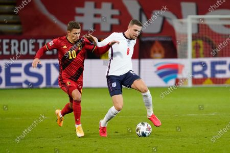 Jordan Henderson of England and Thorgan Hazard of Belgium battle for the ball