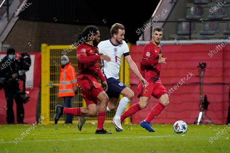 Harry Kane of England takes on Jason Denayer of Belgium and Thomas Meunier of Belgium