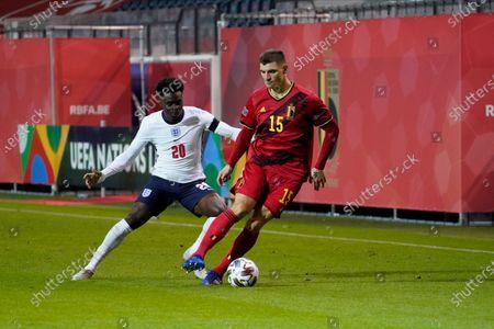 Thomas Meunier of Belgium and Bukayo Saka of England
