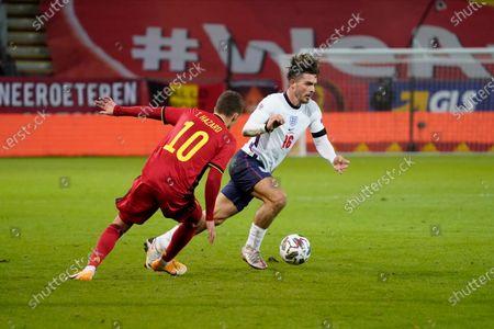 Jack Grealish of England takes on Thorgan Hazard of Belgium