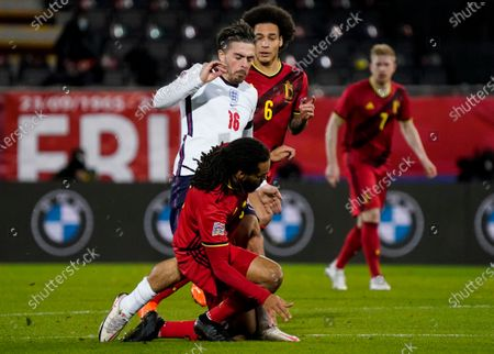 Jack Grealish of England between Jason Denayer of Belgium and Axel Witsel of Belgium