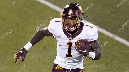 Minnesota running back Cam Wiley carries the ball during the second half of an NCAA college football game against Illinois, in Champaign, Ill. Minnesota won 41-14