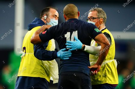 Jonathan Joseph of England goes off injured with back spasms