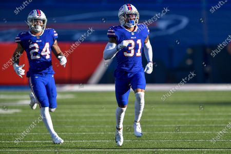 Buffalo Bills safety Dean Marlowe (31) and cornerback Taron Johnson (24) cover a kickoff against the Seattle Seahawks during the second half of an NFL football game, in Orchard Park, N.Y