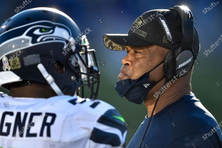 Seattle Seahawks defensive coordinator Ken Norton Jr., right, on the sideline during the second half of an NFL football game against the Buffalo Bills, in Orchard Park, N.Y