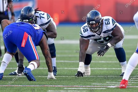 Seattle Seahawks guard Damien Lewis (68) lines up against the Buffalo Bills during the second half of an NFL football game, in Orchard Park, N.Y