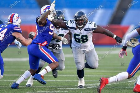 Seattle Seahawks guard Damien Lewis (68) blocks Buffalo Bills defensive lineman Quinton Jefferson (90) during the second half of an NFL football game, in Orchard Park, N.Y