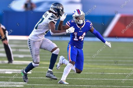 Buffalo Bills wide receiver Stefon Diggs (14) is covered by Seattle Seahawks cornerback Tre Flowers (21) during the second half of an NFL football game, in Orchard Park, N.Y