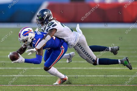 Buffalo Bills wide receiver Stefon Diggs (14) cannot make the catch while covered by Seattle Seahawks cornerback Tre Flowers (21) during the second half of an NFL football game, in Orchard Park, N.Y