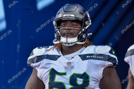Seattle Seahawks guard Damien Lewis (68) walks out of the tunnel for the second half of an NFL football game against the Buffalo Bills, in Orchard Park, N.Y