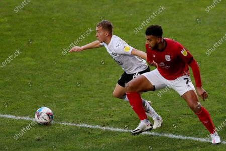 Stock Photo of Daniel Powell of Crewe Alexandra competes with Louis Reed and Dan Butler of Peterborough United